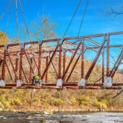 Optimal Design Of Through-Truss Steel Bridges